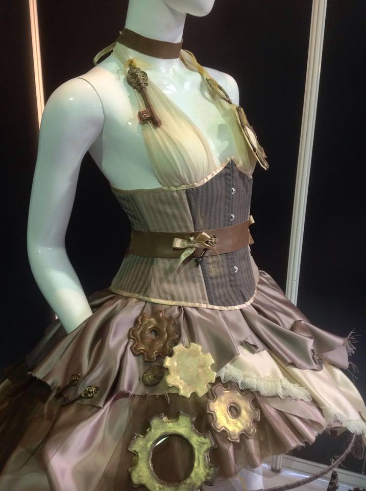 Close up of the corset and top of the skirt with chocolate cogs